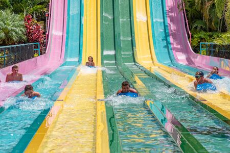 Orlando, Florida. July 01, 2019. People sliding down to staggeringly steep hill in Tamauta Racer at Aquatica 10
