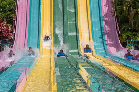 Orlando, Florida. July 01, 2019. People sliding down to staggeringly steep hill in Tamauta Racer at Aquatica 11
