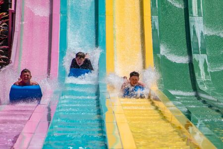 Orlando, Florida. July 01, 2019. People sliding down to staggeringly steep hill in Tamauta Racer at Aquatica 12