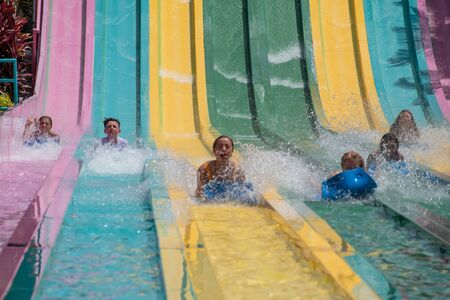 Orlando, Florida. July 01, 2019. People sliding down to staggeringly steep hill in Tamauta Racer at Aquatica 13 Редакционное