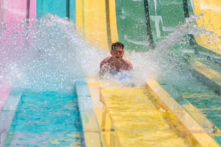 Orlando, Florida. July 01, 2019. Person enjoying amazing splashing in Tamauta Racer attraction at Aquatica 1