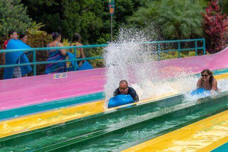 Orlando, Florida. July 01, 2019. Person enjoying amazing splashing in Tamauta Racer attraction at Aquatica 3