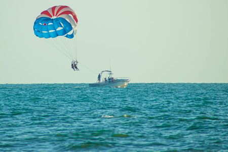 Clearwater Beach, Florida. June 24, 2019. Bayboat and parasail at Pier 60 area. Editorial