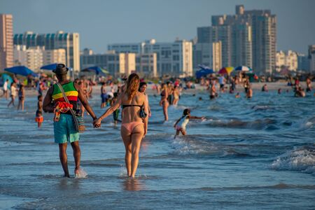 Clearwater Beach, Florida. June 24, 2019. People walking and enjoying the beach at Pier 60 area 3
