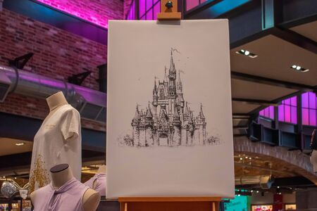 Orlando, Florida. June 15, 2019. Image of Cinderella Castle drawn by hand and Disney clothes at Lake Buena Vista.