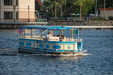 Orlando, Florida. June 15, 2019. Taxi boat sailing in Disney Springs at Lake Buena Vista 1