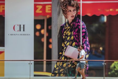 Orlando, Florida. June 6, 2019. People walking in front of Carolina Herrera giant picture in The Mall at Millenia 2