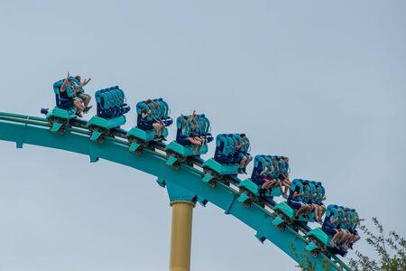 Orlando, Florida. June 17, 2019. People having fun amazing Kraken rollercoaster at Seaworld 7