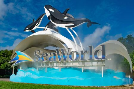 Orlando, Florida. June 17, 2019. Seaworld sign and whale figures on lightblue cloudy background 3