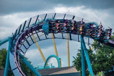 Orlando, Florida. June 17, 2019. Top view of people enjoying terrific Mako rollercoaster at Seaworld 8