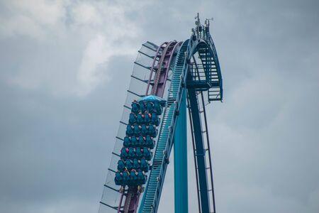 Orlando, Florida. June 17, 2019. Top view of people having fun Mako rollercoaster at Seaworld 1