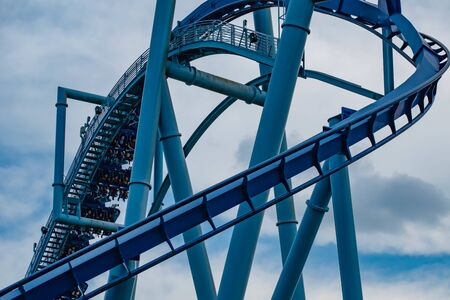Orlando, Florida. June 25 2019. People enjoying amazing Manta Ray roller coaster at Seaworld 3 Редакционное