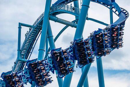 Orlando, Florida. June 25 2019. People enjoying amazing Manta Ray roller coaster at Seaworld 5 Редакционное