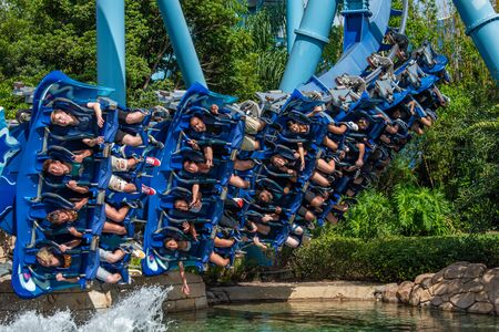 Orlando, Florida. June 25 2019. People enjoying amazing Manta Ray roller coaster at Seaworld 16 Редакционное