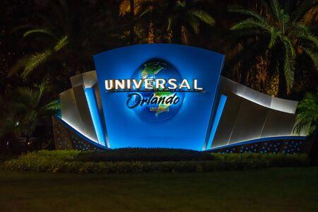 Orlando, Florida. June 13, 2019. Illuminate Universal Orlando on palm trees background at Universal Boulevard.