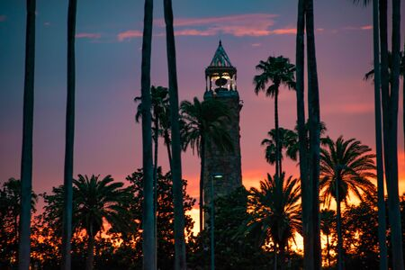 Orlando, Florida. June 13, 2019. Island of Adventure lighthouse on beautiful sunset background at Universal Studios area 1 Редакционное