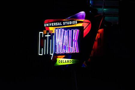 Orlando, Florida. June 13, 2019. Top view of Universal Studios CityWalk sign on dark night background at Universal Studios area.