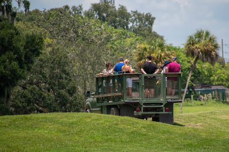 Tampa Bay, Florida. July 12, 2019. Safari truck moves away from giraffes and zebras area at Busch Gardens (3)