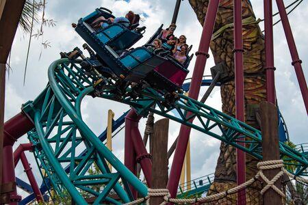 Tampa Bay, Florida. July 12, 2019.People having fun terrific Snakes Curse rollercoaster at Busch Gardens 8