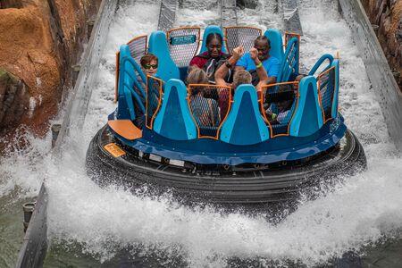 Orlando, Florida. July 13, 2019. People having fun splashing in Infinity Falls at Seaworld 3 Editorial