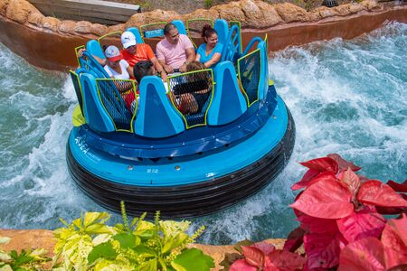 Orlando, Florida. July 18, 2019. People enjoying Infinity Falls water attraction at Seaworld 18