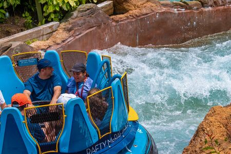 Orlando, Florida. July 18, 2019. People enjoying Infinity Falls water attraction at Seaworld 26 Editorial