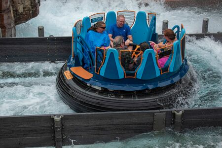 Orlando, Florida. July 13, 2019. People enjoying splashing in Infinity Falls at Seaworld 31 Editorial