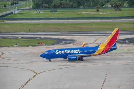 Tampa Bay, Florida. July 12, 2019. Southwest aircraft on runway preparing for departure from Tampa International Airport 4 Editorial