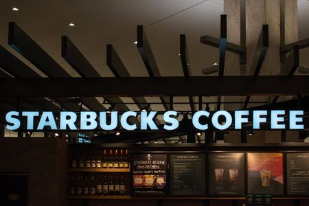 Tampa Bay, Florida. July 12, 2019 Starbucks Coffe sign at Tampa International Airport 2