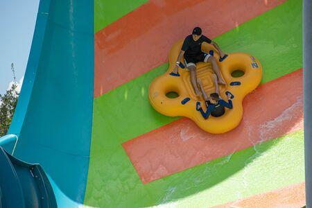 Orlando, Florida. July 29, 2019. People enjoying Kare Kare curl water attraction at Aquatica 11 Editorial