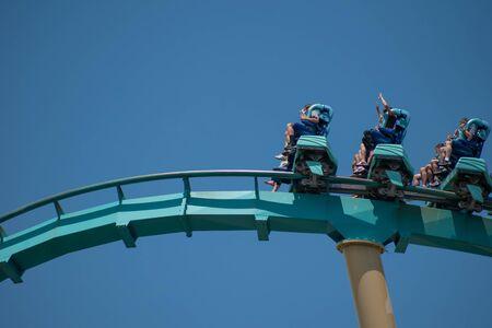 Orlando, Florida . July 29, 2019. People enjoying riding Kraken rollercoaster during summer vacation at Seaworld 1 Editorial