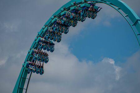 Orlando, Florida . July 29, 2019. People enjoying riding Kraken rollercoaster during summer vacation at Seaworld 7