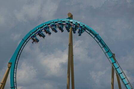Orlando, Florida . July 29, 2019. People enjoying riding Kraken rollercoaster during summer vacation at Seaworld 15
