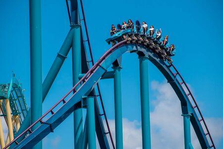 Orlando, Florida . July 29, 2019. People enjoying riding Mako rollercoaster during summer vacation at Seaworld 3