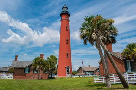 Ponce de Leon Inlet, Florida. July 19, 2019. Panoramic view of historic lighthouse and palm trees 1