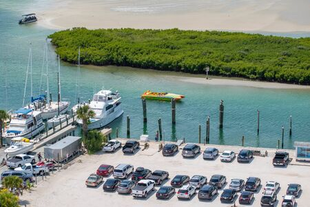 Ponce de Leon Inlet, Florida. July 19, 2019 Partial view of Marina and colorful boat from lighthouse. Редакционное