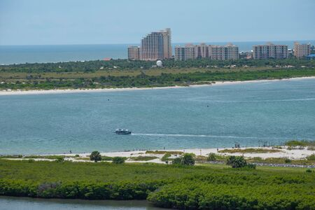 Ponce de Leon Inlet, Florida. July 19, 2019 Partial view of New Smyrna Beach and Halifax River from lighthouse. Редакционное
