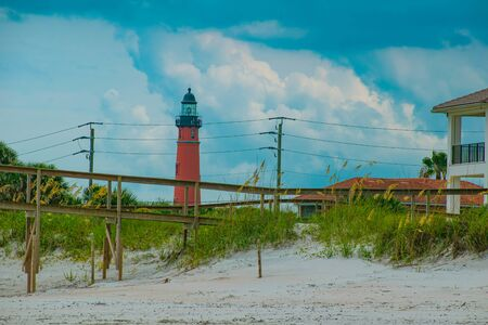 Ponce de Leon Inlet, Florida. July 19, 2019 Partial view of Ponce Inlet lighthouse from beach.