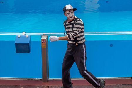 Orlando, Florida. July 26, 2019. Mime artist entertaining people in the minutes before the start of the Sea Lion High Show at Seaworld (2)