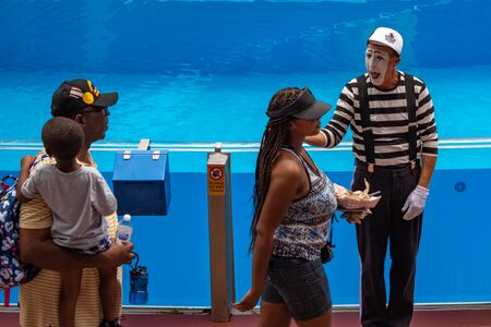 Orlando, Florida. July 26, 2019 Mime artist interacting with people entering the show at Seaworld.