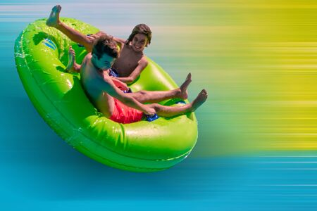 Orlando, Florida. September 20, 2019. People enjoying Karekare curl.This new ride is a curve shaped wave which riders will experience when climbing the vertical wave wall at Aquatica
