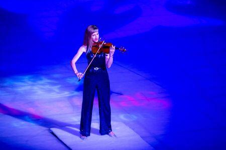 Orlando, Florida . November 23, 2019. Woman violinist playing holiday music on Seaworlds Christmas Celebration (12)