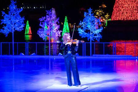 Orlando, Florida . November 24, 2019. Woman violinist playing holiday music on Seaworlds Christmas Celebration (2)