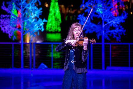 Orlando, Florida . November 24, 2019. Woman violinist playing holiday music on Seaworlds Christmas Celebration (3)