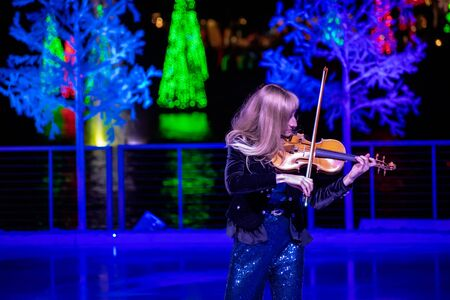 Orlando, Florida . November 24, 2019. Woman violinist playing holiday music on Seaworlds Christmas Celebration (7)