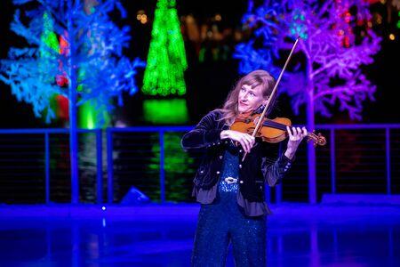 Orlando, Florida . November 24, 2019. Woman violinist playing holiday music on Seaworlds Christmas Celebration (9)
