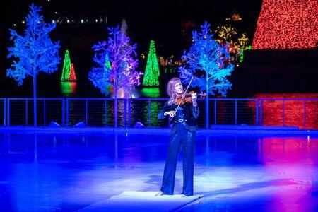 Orlando, Florida . November 24, 2019. Woman violinist playing holiday music on Seaworlds Christmas Celebration (13)