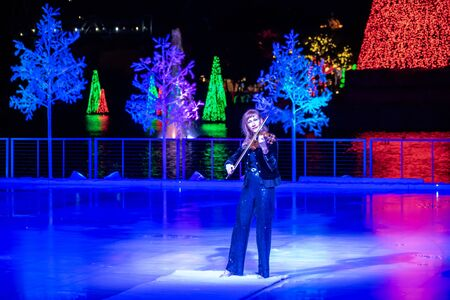 Orlando, Florida . November 24, 2019. Woman violinist playing holiday music on Seaworlds Christmas Celebration (14)