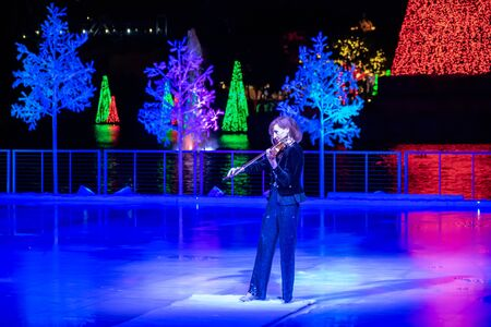 Orlando, Florida . November 24, 2019. Woman violinist playing holiday music on Seaworlds Christmas Celebration (15)