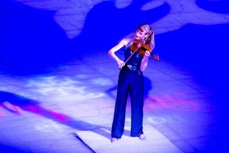 Orlando, Florida . November 23, 2019. Woman violinist playing holiday music on Seaworlds Christmas Celebration (1)